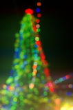 Abstract blurred background in a shape of Christmas tree Royalty Free Stock Image