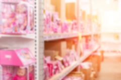 Abstract blurred background of wholesale girs toys and dolls shop. Shelves with pink gift boxes at storage of retail store. Girl, kid, shelf, young, child stock photo