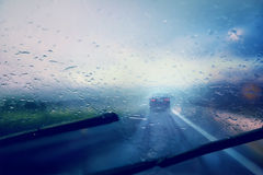 Abstract blurred bad weather vehicle driving Royalty Free Stock Photo
