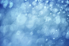 Abstract blurred blue color rain drop bokeh background Royalty Free Stock Image