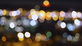 Abstract blurred blue, orange and yellow bokeh lights background stock video