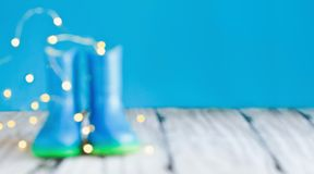 Abstract of Blurred Blue Rain Boots. Abstract bokeh and blurred colorful background of children`s rain boots / wellies with bokeh agaisnt a blue background with royalty free stock photo