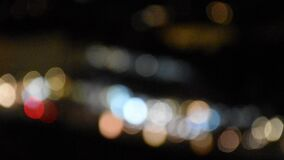 Abstract blurred bokeh background, city lights at night.  stock video footage