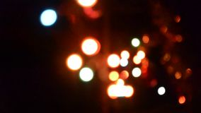 Defocused Blinking Lights Background Abstract Blurred Bokeh Blinking Garland. stock footage