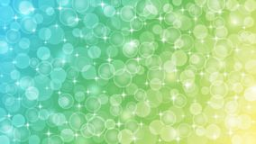 Abstract Blurred Bokeh, Sparkles and Bubbles in Pastel Blue, Green and Yellow Background
