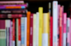 Abstract blurred bookshelf with colorful bright books. Education and interior concept. stock photo
