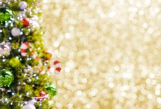 Abstract blurred christmas tree on gold bokeh background royalty free stock photography