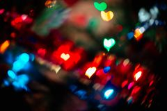 Abstract blurred colorful christmas bokeh heart background. Abstract blurred colorful christmas bokeh background heart shape. Toned, style photo stock photography
