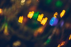 Abstract blurred colorful christmas bokeh heart background. Abstract blurred colorful christmas bokeh background heart shape. Toned, style photo stock photo