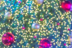 Abstract blurred colorful Christmas tree lighting decoration with bokeh background. Defocused of decorated and illuminated christm. As tree for Merry Christmas royalty free stock image