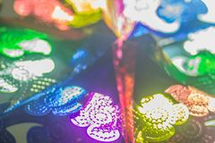 Abstract blurred colorful garlands are hanging on the ceiling at the office to decoration prepare for Christmas and new year party. Cerebration Royalty Free Stock Images