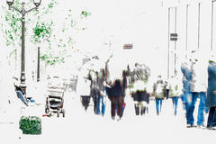 Abstract blurred crowd moving against a background of an urban landscape. For your design. Copy space Stock Photos
