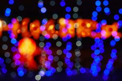 Abstract blurred Defocused image of night lights with motion blur background royalty free stock photo