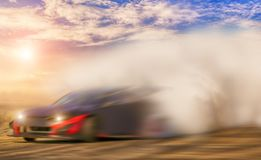 Abstract blurred drift car with smoke from burned tire.  royalty free stock photography