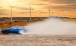 Abstract blurred drift car with smoke from burned tire at wind t. Urbine field royalty free stock photos