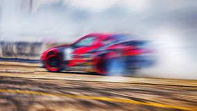 Abstract blurred drift cars with smoke from burned tire. On speed track Stock Photo