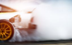 Abstract blurred drift cars with smoke from burned tire royalty free stock photography