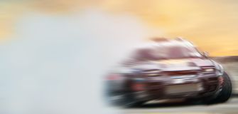 Abstract blurred drift cars with smoke from brned tire o stock photo