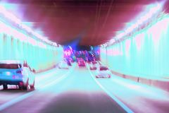 Abstract blurred driving in the tunnel at night, moving cars, urban street illumination. Concept of modern lifestyle of. Abstract blurred driving in the tunnel stock images