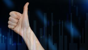 Abstract Blurred Finance Background. Thumbs up on Stock Market Graph and Bar Candlestick Chart.  stock photography
