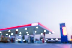 Abstract blurred of gas station or petrol station. With dark blue sky during twilight time royalty free stock image