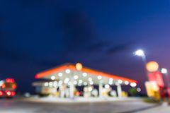 Abstract blurred of gas station or petrol station. With dark blue sky during twilight time stock image