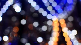 Blurred colorful lights on evening street stock footage