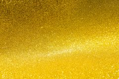 Abstract blurred gold glitter background. Shiny gold background Royalty Free Stock Image
