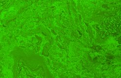 Abstract blurred green background with elements of spreading green paint. And with effect of marble texture Royalty Free Stock Photography