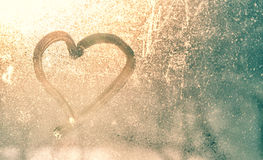 Abstract blurred heart shape on frozen window Stock Image