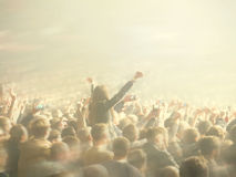 Abstract blurred image. Crowd during a entertainment public concert a musical performance. Hand fans in fun zone people Royalty Free Stock Photography