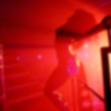 Abstract blurred image of dancing woman in night club as a backg Stock Image