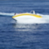 Abstract blurred image of fast motor boat as a background Stock Image
