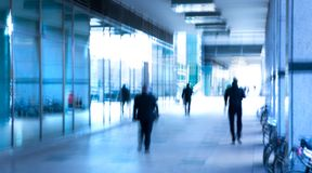Abstract, blurred image of people walking via long tunnel with light at the background. London, UK Royalty Free Stock Photo