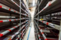 Blurred interior of hardware shop storage. Abstract blurred interior of house appliances store warehouse Royalty Free Stock Photo