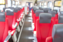 Abstract blurred Interior of train with empty seats Stock Image