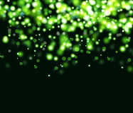 Abstract blurred light background. Abstract black background wiht green spotlight Stock Images