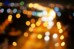 Abstract blurred lights highway with city downtown background. With circular blurry bokeh Royalty Free Stock Photography