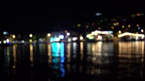 Abstract blurred lights of a night sea town.  stock video