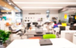 Abstract Blurred Of Modern Office Work Space Of Table Work In
