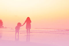 Abstract blurred Mother and children playing on the beach sunset stock images