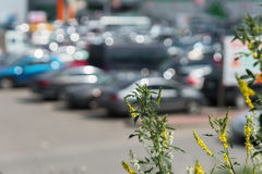 Abstract blurred outdoor parking next to modern shopping mall, sunny summer day, season sales, for background Royalty Free Stock Images