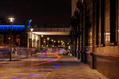 Abstract blurred part of the street is lit at night Stock Photo