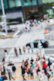 Abstract blurred people crossing the street outside Stock Images