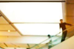 Abstract blurred people passenger on escalator for background stock image