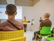 Abstract blurred photo of conference hall or seminar room with a stock images