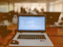Abstract blurred Photo of Laptop in the office royalty free stock photo