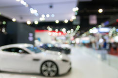 Abstract blurred photo of motor show, car show room.  Royalty Free Stock Photos