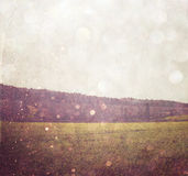 Abstract blurred photo of open field view with texture and glitter overlay.  Stock Image