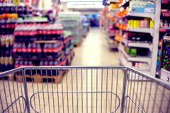 Abstract blurred photo of store with food trolley at a supermarket stock image